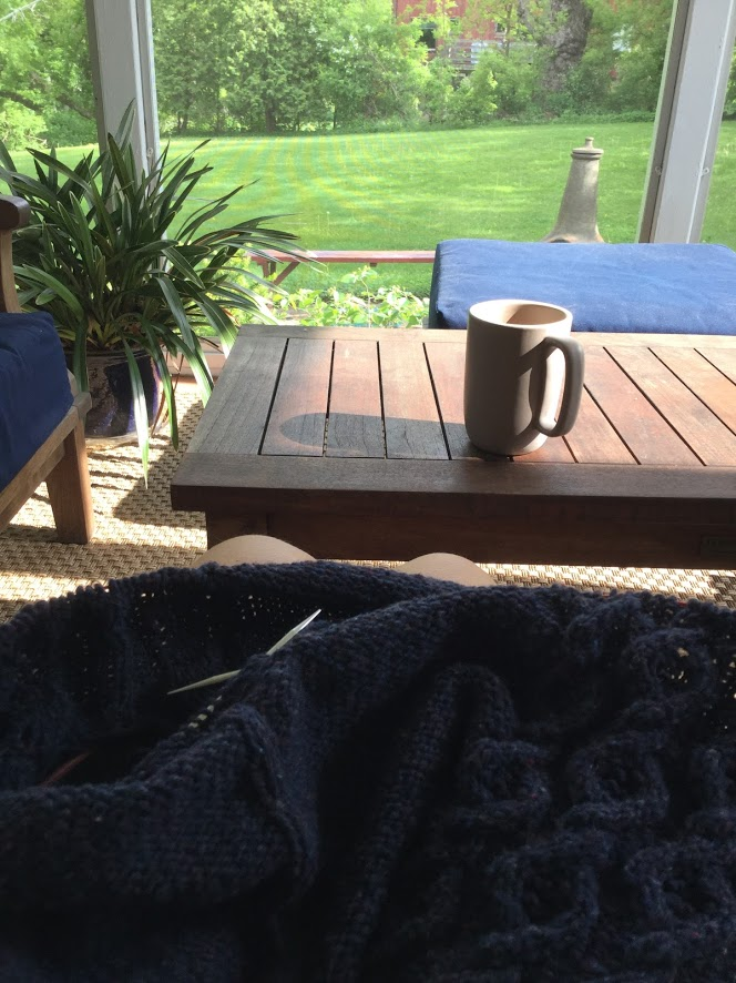 knitting on porch